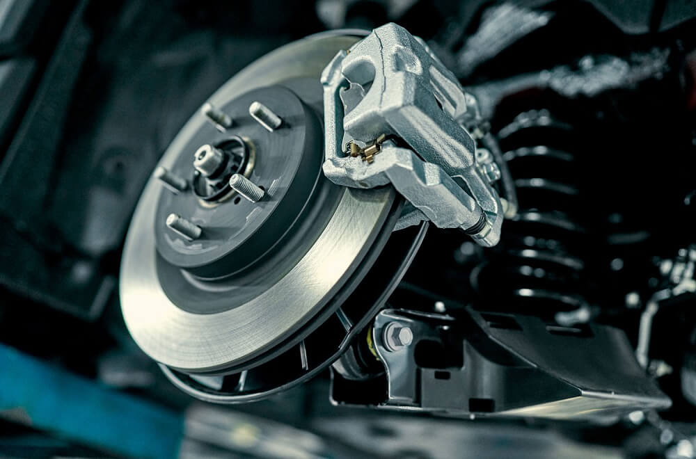 Close up image of a vehicle's disc brakes.